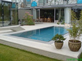 Stainless steel pool with terrace